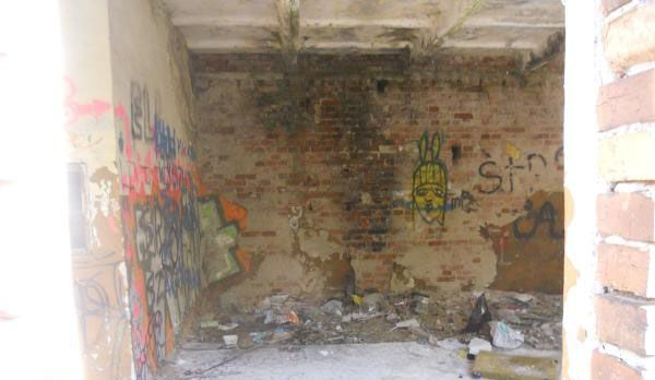 Photo of the inside of that building, and again with graffiti