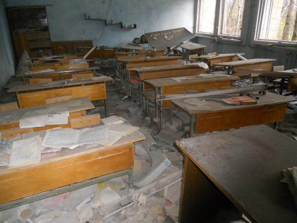Abandoned school room with desks and books still there