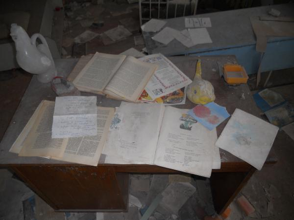 Books (probably left there by a photographer) in the abandoned nursery at Chernobyl