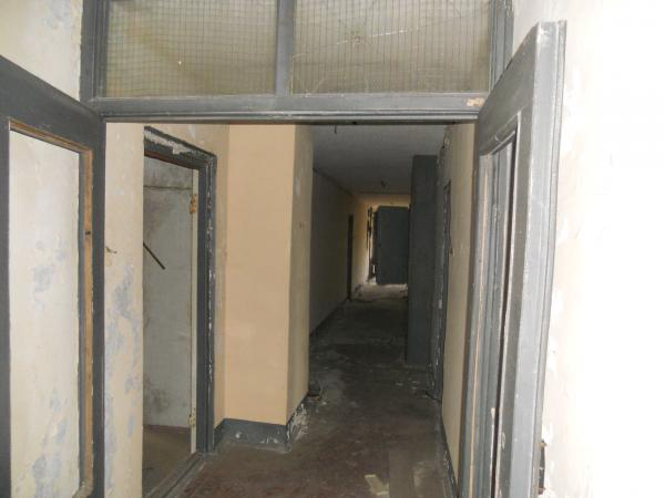 Entering the apartment block, on the ground floor