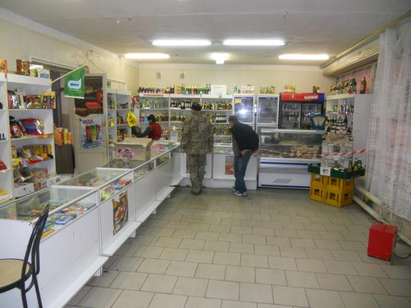 Our tour guide and his driver buying cigarettes in the only shop in the area