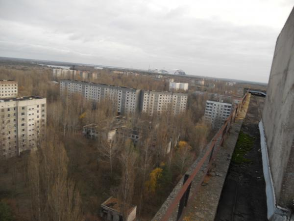 On the roof - looking over Pripyat and you can see the Chernobyl power station in the distance