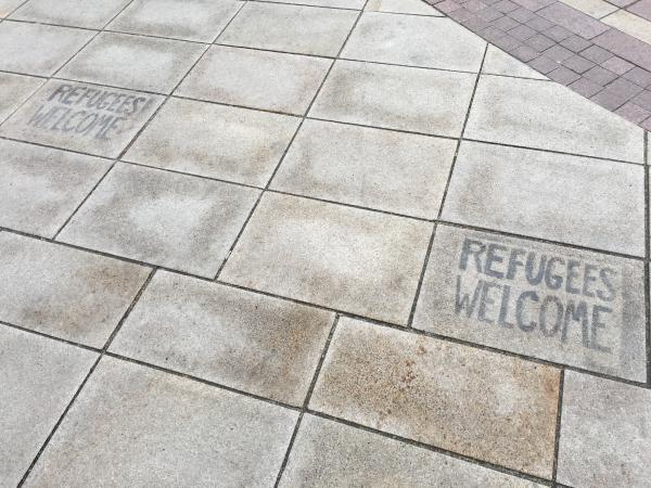 We found some graffiti with the words 'Refugees Welcome' on the floor
